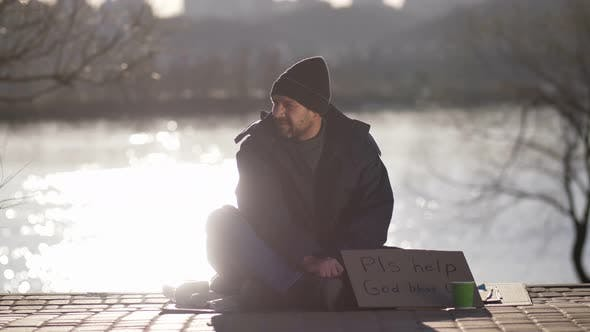 Cover Image for Mature Beggar Asking for Money Help on Street