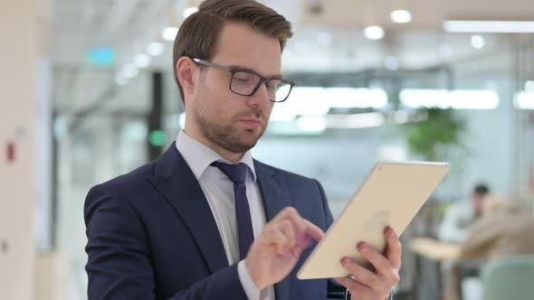Thumbnail for Businessman Browsing Internet on Tablet, Online Business