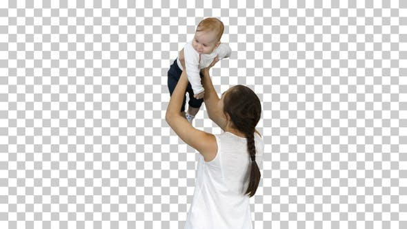 Thumbnail for Young mama playing with baby by rising him up, Alpha Channel