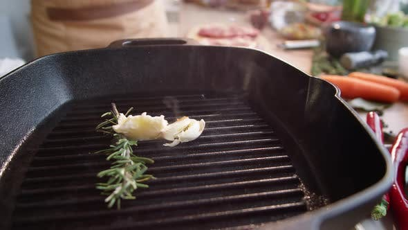 Thumbnail for Melting Butter, Rosemary and Garlic on Hot Grill Pan