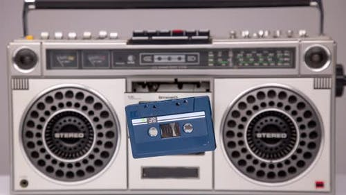 Cassette Tape Coming Out of Stereo Hifi