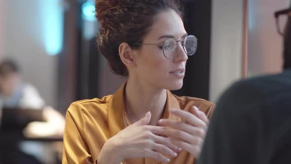 Caucasian Woman Telling Black Boyfriend about Work Problems in Cafe