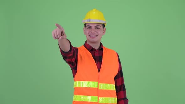 Thumbnail for Happy Young Multi Ethnic Man Construction Worker Directing and Pointing Finger