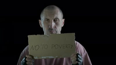 No poverty. A man with a sign of no poverty