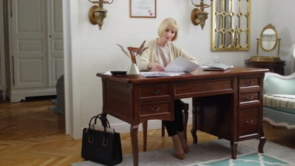Thumbnail for Middle-aged Blonde Businesswoman Working