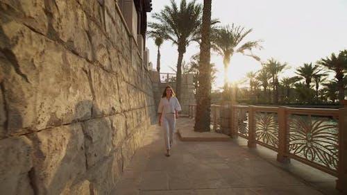 Woman Walking on the Riverfront in Luxury Residential Neighborhood in Dubai