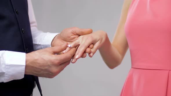 Thumbnail for Close Up of Man Giving Diamond Ring To Woman