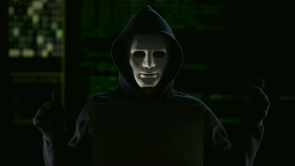 Thumbnail for Hacker in mask and gloves breaking government servers