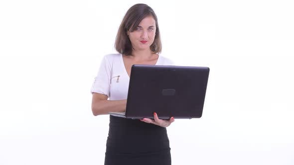 Thumbnail for Happy Beautiful Businesswoman Thinking While Using Laptop