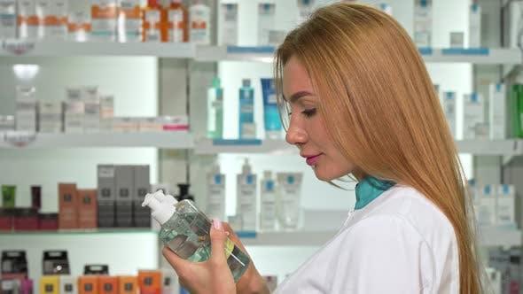 Thumbnail for Female Pharmacist Smiling To the Camera, Holding Two Medication Bottles