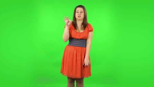 Thumbnail for Cute Girl Is Showing Disgust for Bad Smell or Taste. Green Screen