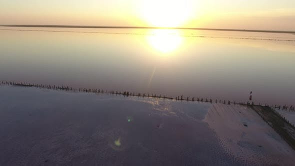 Thumbnail for Aerial Shot of Shiny Waters of Black Sea Coast with Lines at Splendid Sunset in Summer