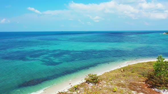 Thumbnail for Wide angle aerial island view of a sunshine white sandy paradise beach and aqua blue water backgroun