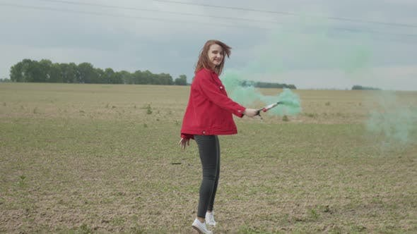 Thumbnail for Woman with Colored Smoke Bomb Enjoying Nature