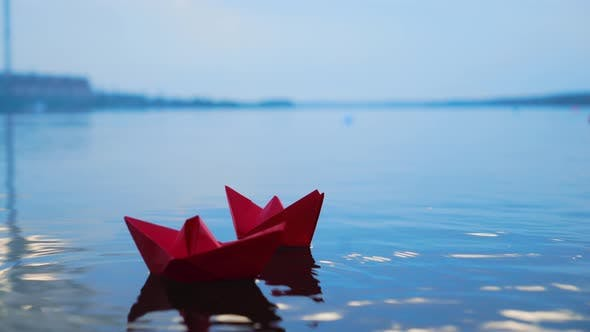 Thumbnail for Womans Hand Putting Paper Boat on the Water