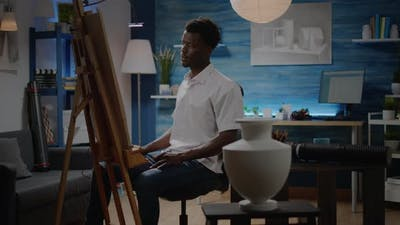 Black Man in Art Studio Preparing for Creativity Process