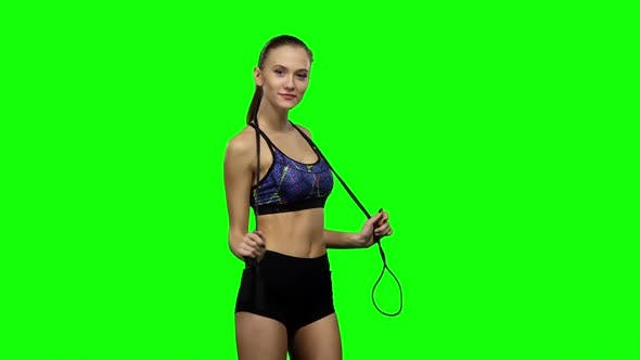 Thumbnail for Woman Holding Jump Rope on Her Shoulders. Green Screen