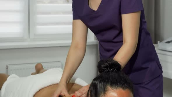Thumbnail for Beautiful Masseuse Smiling To the Camera While Working at Spa Center