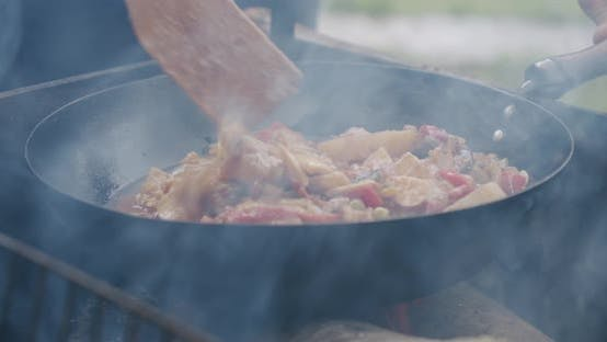 Thumbnail for Close Up Fresh Vegetables Are Cooked in a Pan on Open Fire in the Open Air. Slow Motion