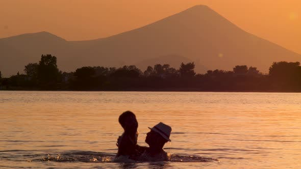 Thumbnail for Summer Vacation. Happy Father Playing with Son in Sea on Sunset Background. Children Psychology