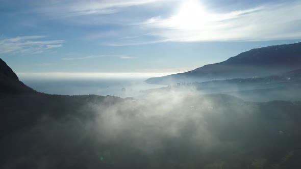Thumbnail for Aerial View Of Endless Ocean, Coastline Near High Mountain In Clouds