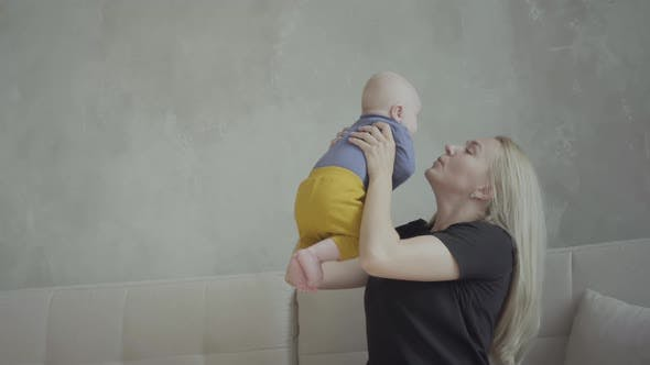 Woman playing with toddler at home