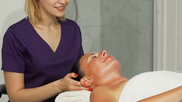 Thumbnail for Relaxed Happe Woman Getting Head Massage at Spa Center