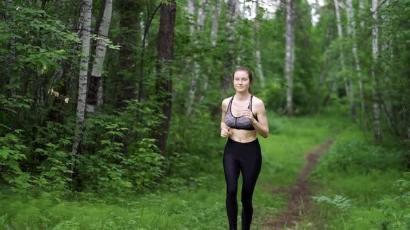 Thumbnail for Young Woman Runner Training in Summer Park