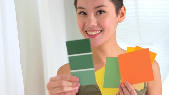 Thumbnail for Playful Chinese woman with paint chips