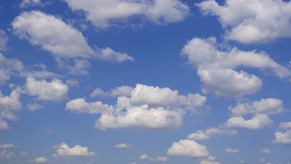 Cumulus Clouds Against the Blue Sky