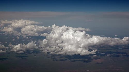 Airplane View of Partly Cloudy and Cumulus Clouds Condensed in Clusters in Humid Warm Air