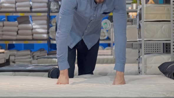Thumbnail for Man Choosing Orthopedic Mattress Lying on a New Bed at the Store