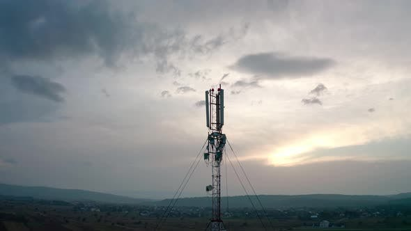 Aerial Drone View. Communication Transmitter Tower in the Countryside. Midel Shot