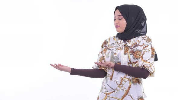 Thumbnail for Stressed Young African Muslim Woman Showing Something