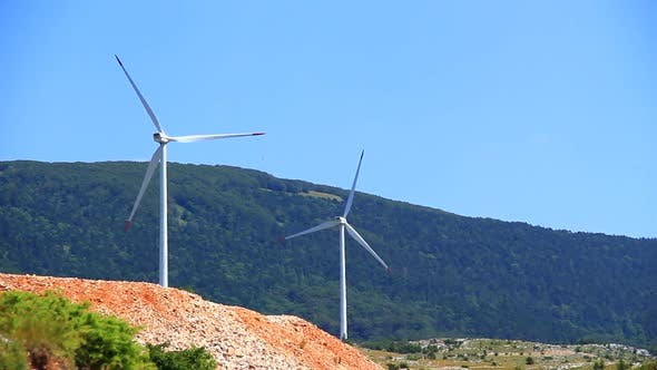 Thumbnail for Pair of Big Wind Turbines Rotating and Generating Electricity