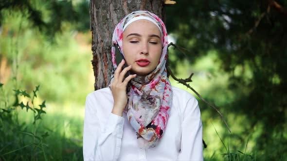 Thumbnail for Modern Muslim Girl Talking on Mobile Outdoor
