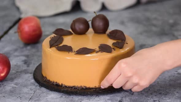 Thumbnail for Pastry Chef Decorating the Mousse Cake with Small Chocolate Pieces. Pastry Chef Decorated Modern
