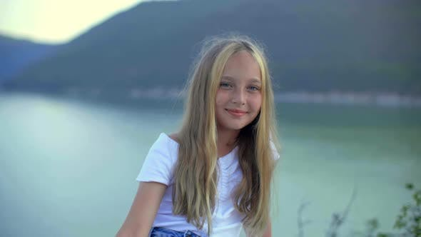 Thumbnail for Portrait Beautiful Girl Teenager Posing Front Camera on Summer Lake Landscape. Young Smiling Girl