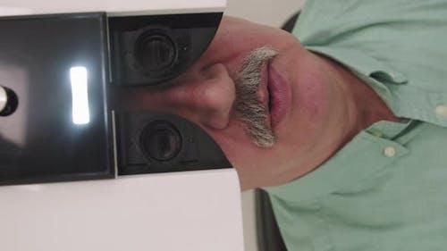 Elderly Man Doing Eye Vision Test