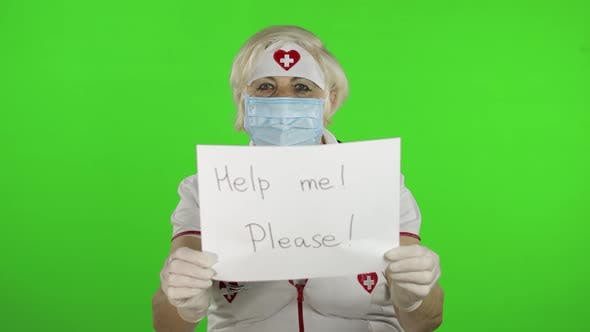 Thumbnail for Elderly Female Doctor in Medical Mask Show Page with Message. Coronavirus