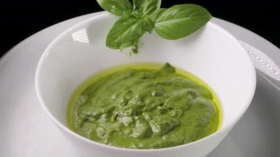 Cover Image for Pesto Sauce in a White Cup