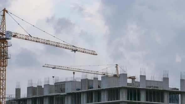 Thumbnail for Building Construction. Tower Crane on a Construction Site, Builders Work, Timelapse