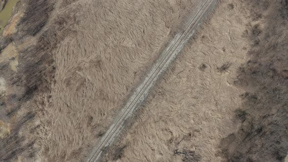Thumbnail for Above the railroad in the valley 4K aerial footage