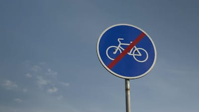 """""""no cycling"""" sign against blue sky. No cyclists' travel sign. """"No bicycles"""" sign."""