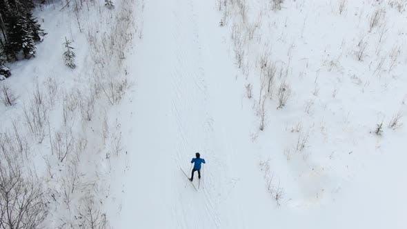 Thumbnail for Sportsman Skies Along Snowy Mountain Slope at Popular Resort