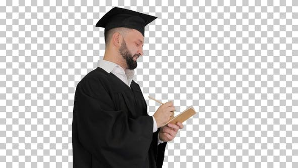 Thumbnail for Thoughtful graduation man writing down his goals, Alpha Channel