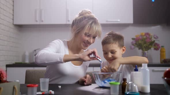 Thumbnail for Happy Mom with Son Making Slime in Home Kitchen