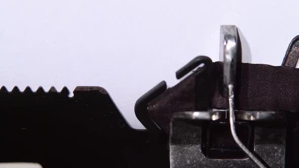 Thumbnail for Impossible Is the Word on a Typewriter. Close Up