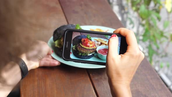 Thumbnail for Woman Hand Taking Picture Of Burger With Smartphone