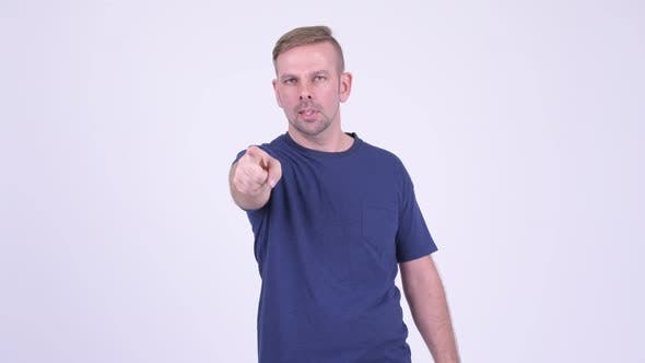 Thumbnail for Portrait of Happy Blonde Man Pointing To Camera